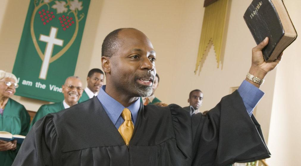 preacher preaching the gospel in church