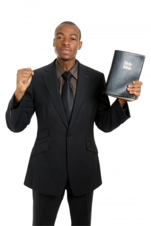 preacher holding the holy bible